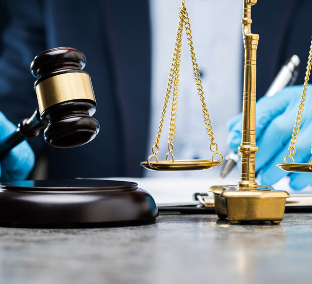 shutterstock_1692360568 law with gloves